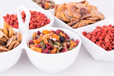 chinese wolfberry: Dried fruits, berries and seeds in bowls closeup picture.