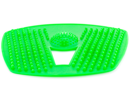 Foot green plastic massage pad isolated on white background.