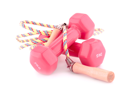 Two plastic coated dumbells and skipping rope isolated on white background.