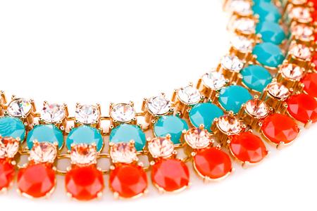 Stylish earrings with stones isolated on white background. Stock Photo