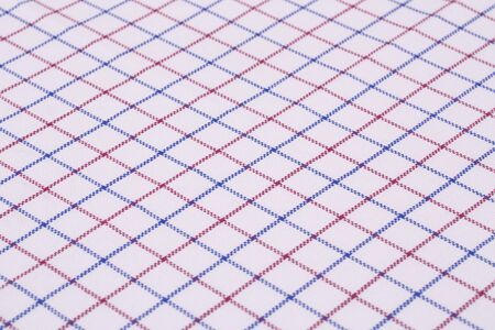 Checkered tablecloth texture as a background, closeup picture. Stock Photo