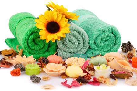 formed: Spa set with towels, candles, flowers and various formed soaps closeup picture.