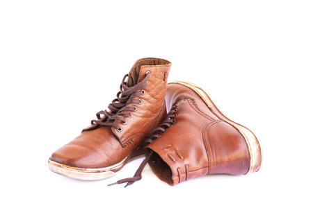 Brown stylish boots isolated on white background.