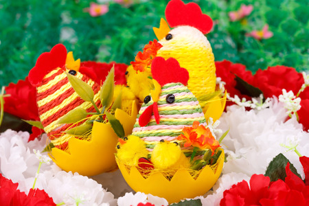 Easter setting with hens, chickens and eggs on flowers nest. Stock Photo