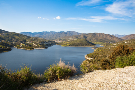 Cyprus landscape with mountains, lake and village. Stock Photo