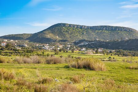 Cyprus landscape with mountains and village. Stock Photo