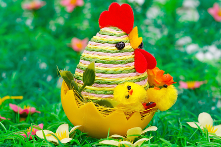 Easter setting with hen, chickens and egg on grass nest. Stock Photo