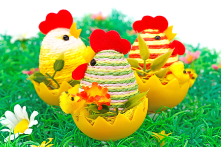 Easter setting with hens, chickens and eggs on grass nest. Stock Photo