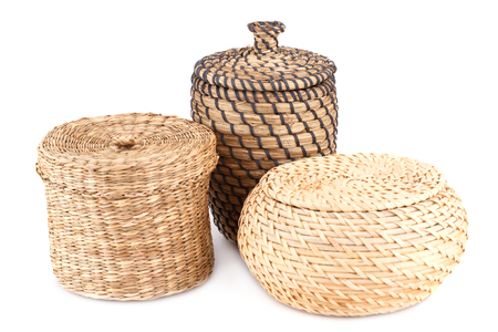 Three wicker boxes isolated on white background.