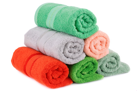 absorb: Rolled towels isolated on white background. Stock Photo