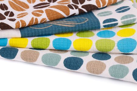 dishtowel: Stack of colorful kitchen towels on white background.