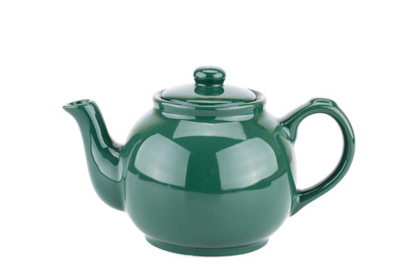 Green teapot isolated on a white background. Stock Photo