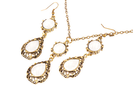 Ancient style necklace and earrings isolated on a white background.