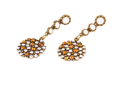 personal ornaments: Ancient style earrings isolated on white background. Stock Photo