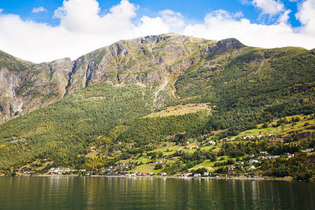 Landscape with Naeroyfjord, mountains and traditional village houses in Norway. Stock Photo