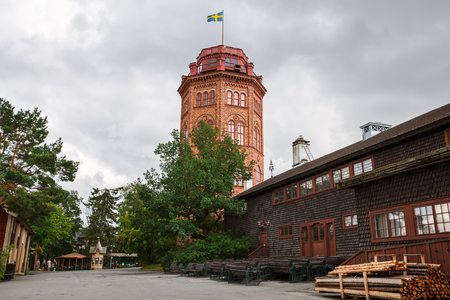 Stockholm, Sweden - August 11, 2014- Traditional old house and Bredablick tower dated 1874 at Skansen, the first open-air museum and zoo, located on the island Djurgarden. Editorial