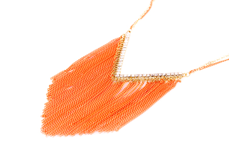 Stylish necklace with orange chains  isolated on white background.
