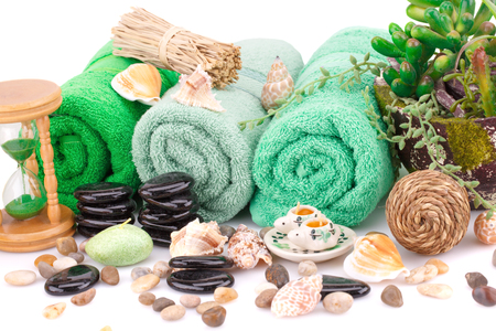 Spa set with towels, candles, shells, plants and stones isolated on white background.