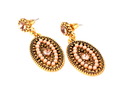 Ancient style earrings isolated on white background. Stock Photo