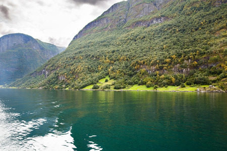 Landscape with Naeroyfjord and high mountains in Norway.