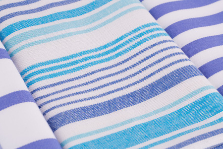Blue and white kitchen towels closeup picture. Stock Photo
