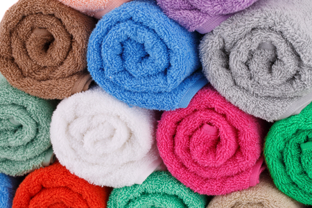 Colorful rolled towels stack closeup picture. Stock Photo