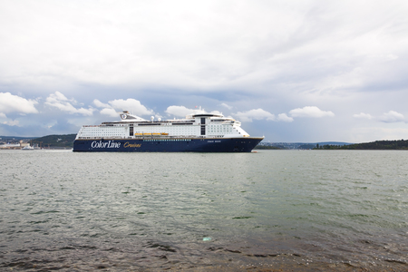 Oslo, Norway-August 13, 2014 - Coastline with cruise liner with people on it. Editorial