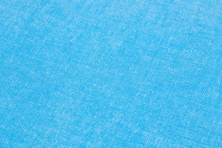 Blue tablecloth texture as a background, closeup picture.