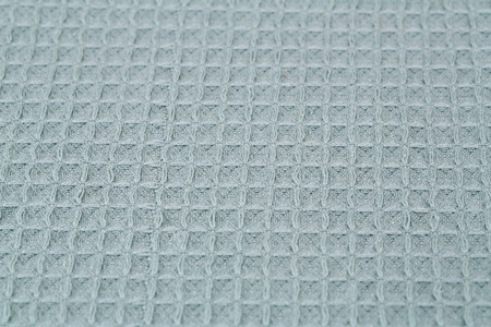 Checkered tablecloth texture as a background, closeup picture. 版權商用圖片