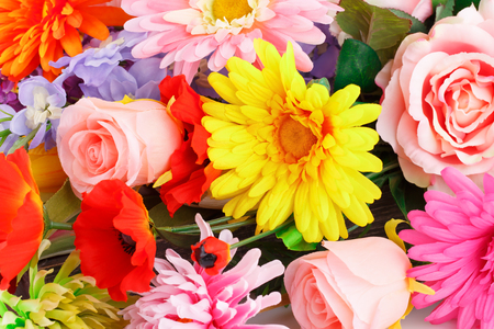 Colorful fabric flowers closeup picture.