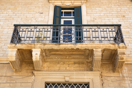 Old building with beautiful balcony in Limassol, Cyprus.