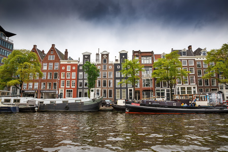 Amsterdam, Netherlands-August 18, 2015-Canal with boats and buildings, view from the water.