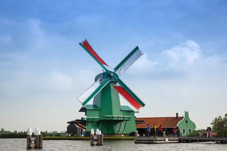 Zaanse Schans, Netherlands, August 19, 2015 - Traditional, authentic dutch windmill at the river Zaam.