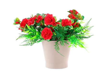 Red fabric flowers  in vase isolated on white background. Foto de archivo