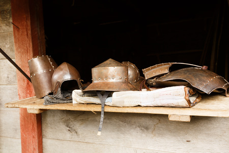 The medieval helmets in The Middle Ages Center, the experimental living history museum. 写真素材 - 114127268