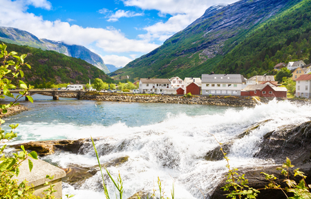 Landscape with mountains, houses, bridge and river in Hellesylt, Norway. Stock Photo