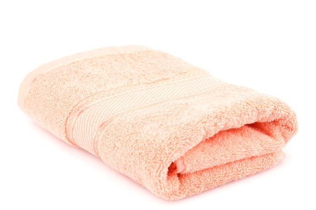Folded towel isolated on white background.