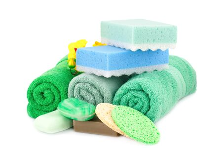 Spa set with towels, soaps, sponges and orchid flowers isolated on white background.