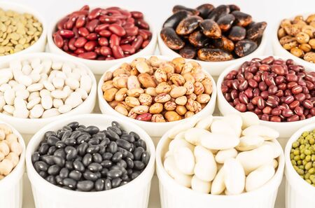 The collection of different beans and lentils in the ceramic bowls. Stok Fotoğraf