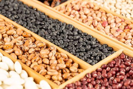 Different beans in the wooden box. Scaelet runner, black turtle, borlotti, black eyed, adzuki.