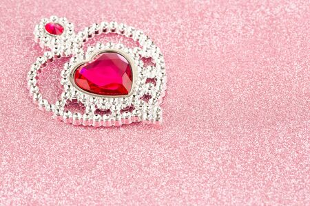Jewelry heart with stones on pink sparkling background. Stock Photo