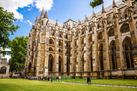 London, UK - August 8, 2019 - Westminster Abbey - Collegiate Church of St Peter at Westminster and many unidentified travelling tourists.