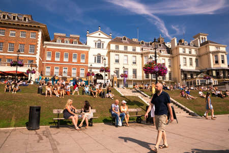 London, UK - August 24, 2019 - People relaxing at the Thames riverside in hot sunny summer day in Richmond. Editorial