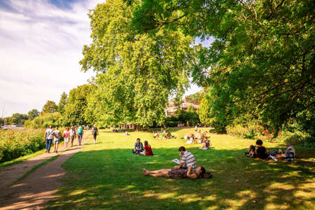 London, UK - August 24, 2019 - People relaxing in Richmond park in hot sunny summer day.