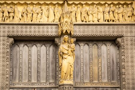 Virgin Mary and Babe Jesus Christ statue at Westminster Abbey's facade.