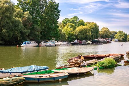 Thames riverfront with many boats in Richmond, London, UK. Imagens