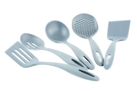 Set of gray plastic kitchen utensils isolated on white background.