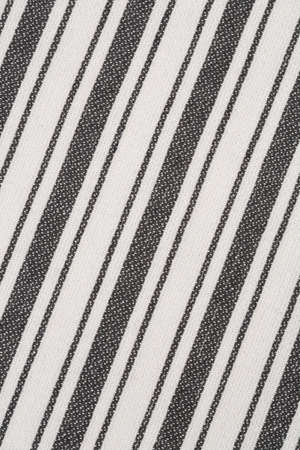 Black and white kitchen towel texture as a background, vertical picture.