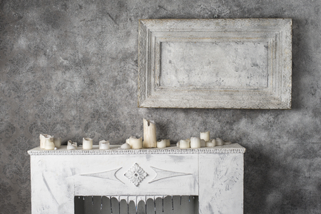 mantles: Burned wax candles on the old fireplace