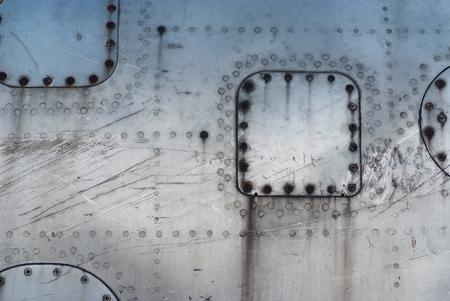 aircraft rivets: texture fuselage damaged aircraft Stock Photo